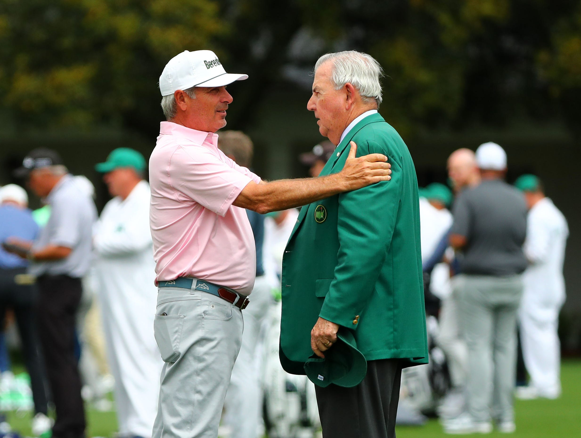 Apr 9, 2019; Augusta, GA, USA; Masters champion Fred Couples talks with Augusta National member Johnny Harris (right) at the practice facility during a practice round for The Masters golf tournament at Augusta National Golf Club. Mandatory Credit: Rob Schumacher-USA TODAY Sports