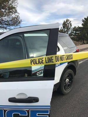 Flagstaff Police vehicle behind police tape.