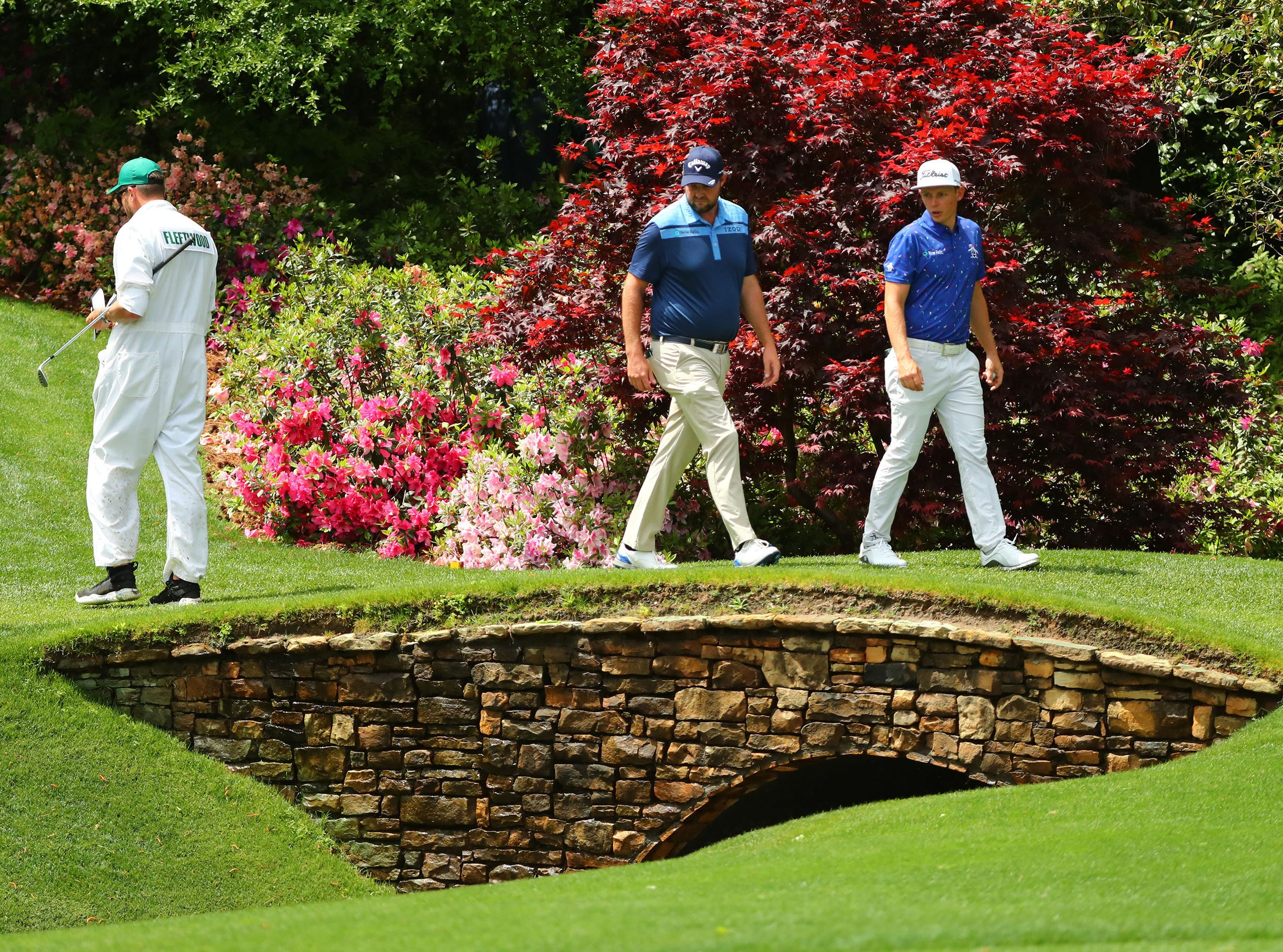Apr 9, 2019; Augusta, GA, USA; Marc Leishman of Australia and Cameron Smith of Australia (right) look down into Rae's Creek on the 13th hole during a practice round for The Masters golf tournament at Augusta National Golf Club. Mandatory Credit: Rob Schumacher-USA TODAY Sports