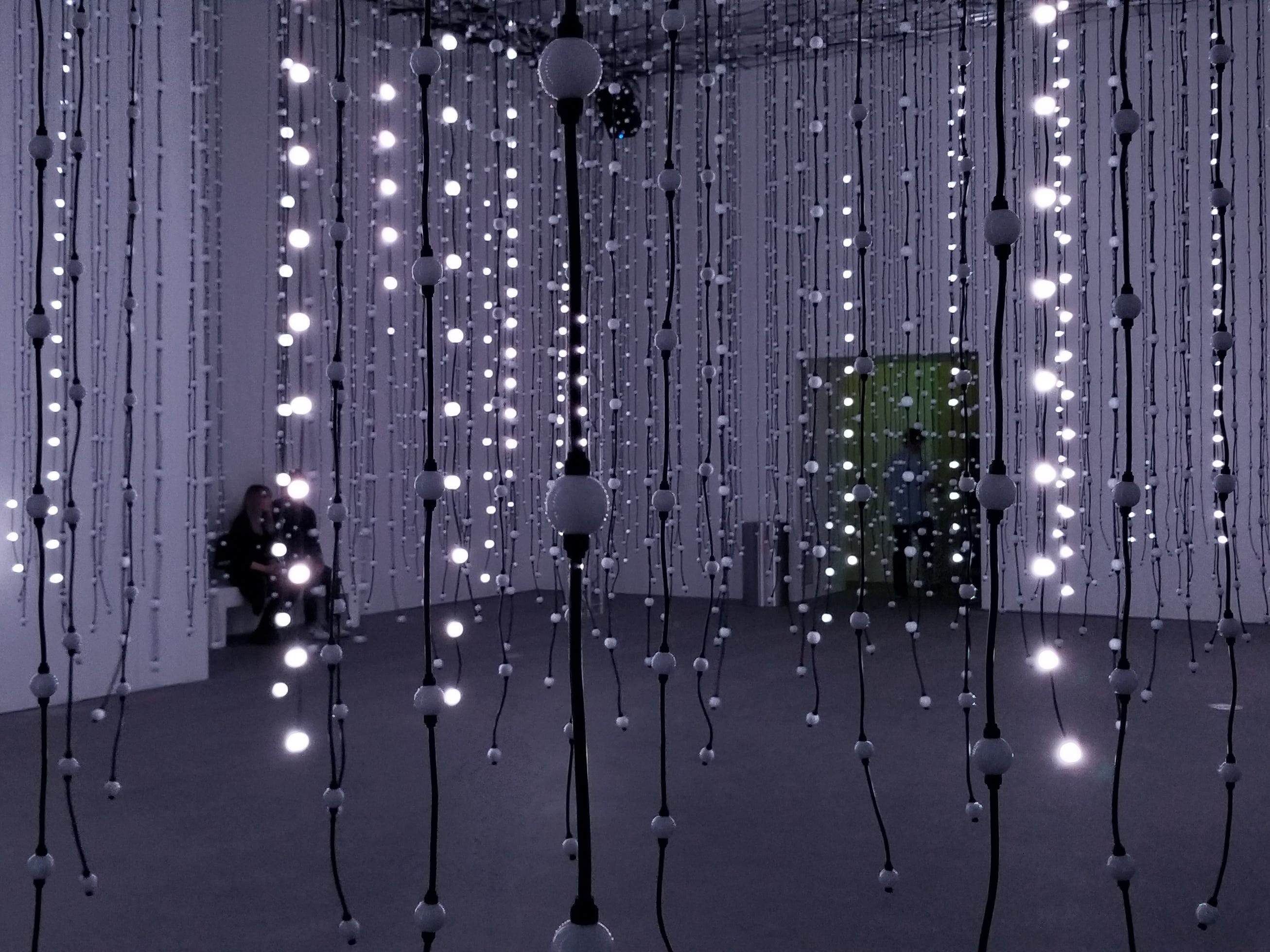 """""""Submergence"""" by Squidsoup is composed of 8,064 individual points of light that continually change colors in correspondence to music. The artwork is part of Wonderspaces Arizona, an immersive art show open April through mid-July 2019 at Scottsdale Fashion Square."""