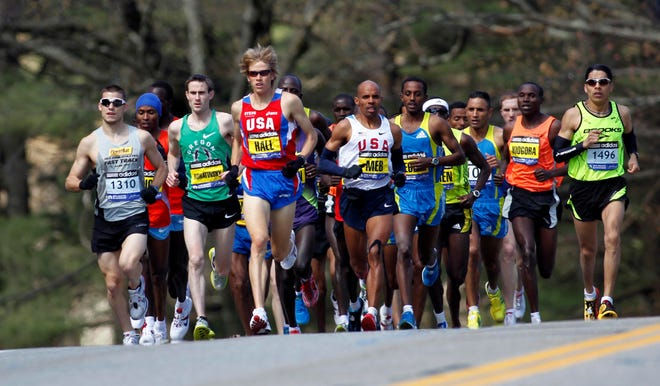 Ryan Hall finished in the top five at the Boston Marathon from 2009-11 and now is coaching his wife Sara, who will make her Boston Marathon debut on Monday.