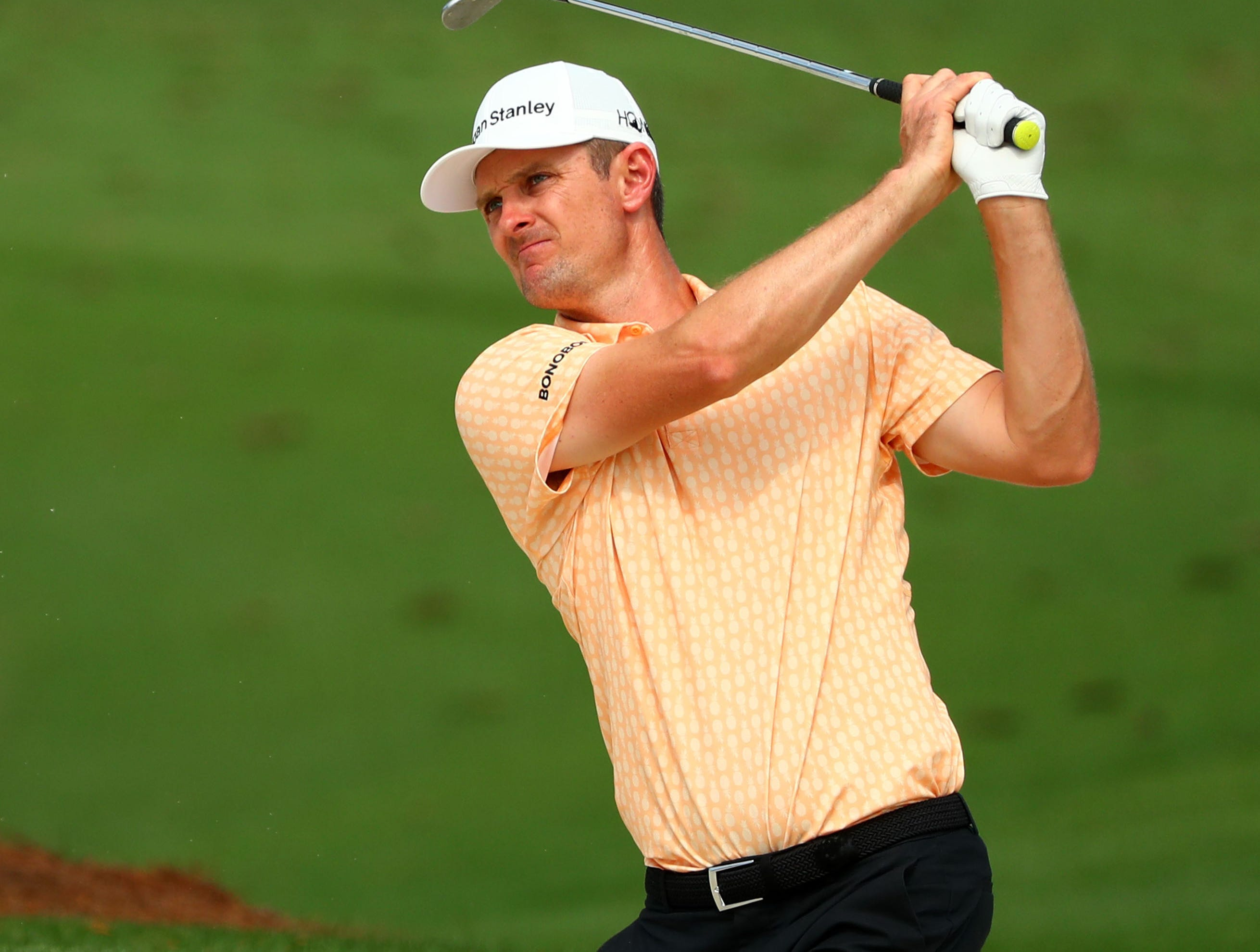 Apr 9, 2019; Augusta, GA, USA; Justin Rose of England hits balls from a bunker at the practice facility during a practice round for The Masters golf tournament at Augusta National Golf Club. Mandatory Credit: Rob Schumacher-USA TODAY Sports
