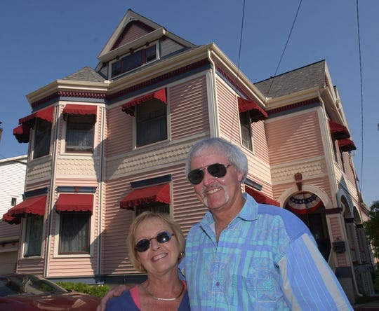 Gayle and Rock Stevens outside their historic Queen Anne-style home in 2003.