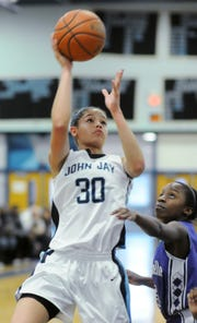 John Jay High School's Calli Balfour shoots in a game against New Rochelle in 2013. Balfour was named SUNY Ulster's head women's basketball coach on April 1.