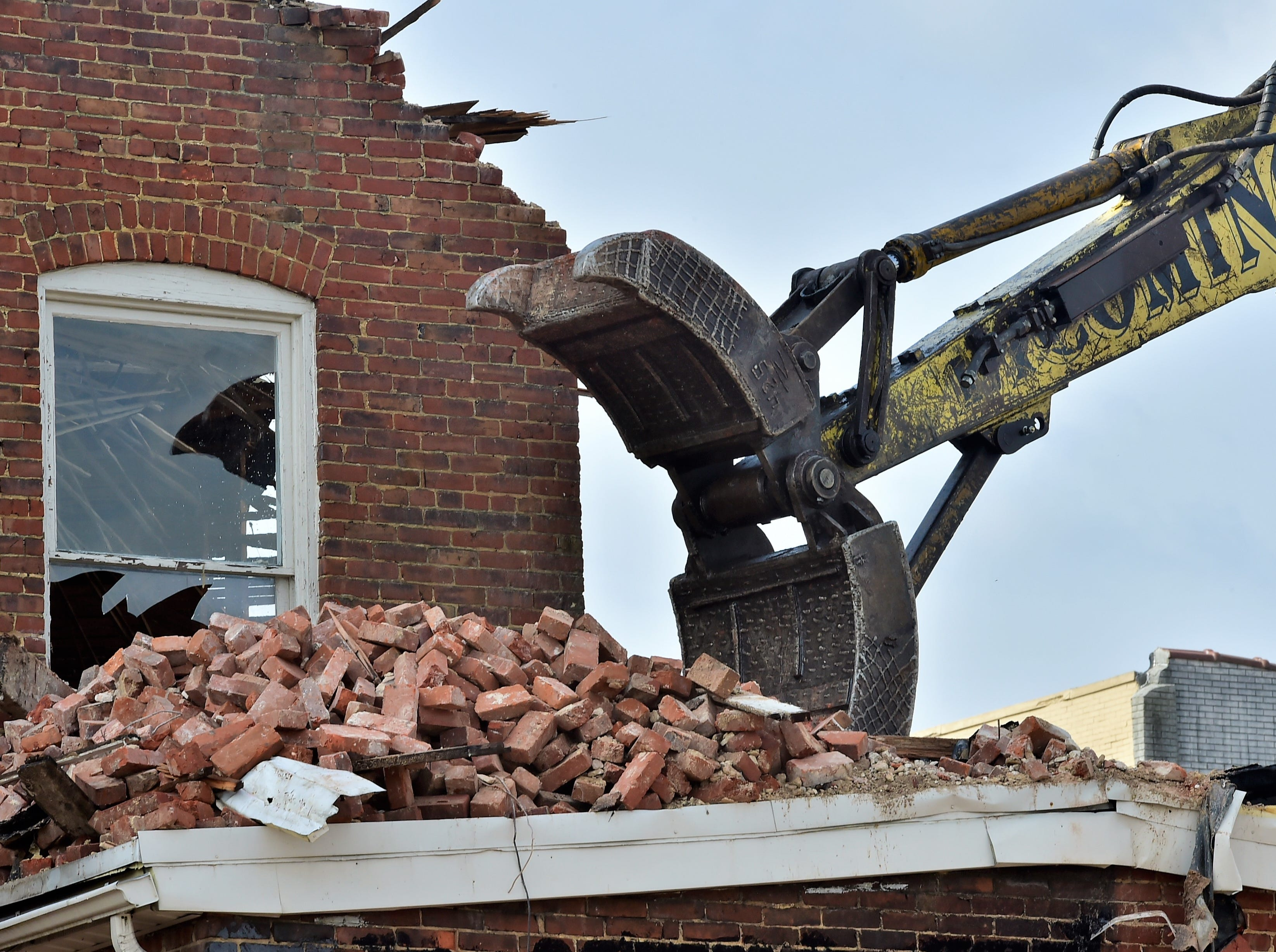The old Wogan's Uniform building on North Main Street, Chambersburg, is demolished on Tuesday, April 9, 2019. Traffic will be limited to one lane through the end of the week as work continues. Lycoming Supply is tearing down structures in the first block of North Main Street as part of the $67.8 million Franklin County Court Facility Improvement Project. A judicial center will be built in the space.