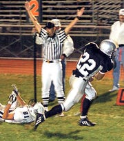 In this file photo, a South Western player slips by Dallastown's Benjamin Hines (81) for a touchdown during a game in September 2005.