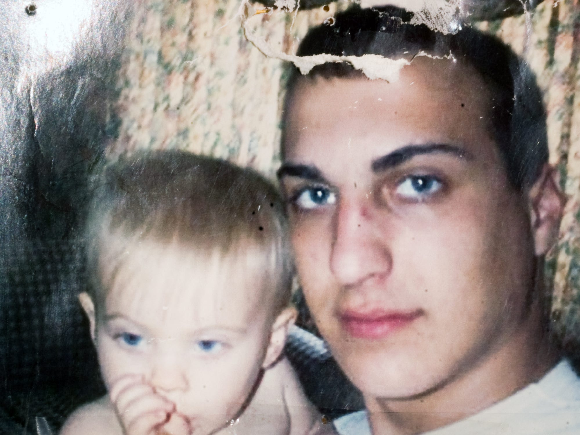 Army Pfc. Corey Small is shown with his young son before his death in Iraq in 2003. The 20-year-old from East Berlin died in July 2003 from a self-inflicted gunshot wound in Baghdad, according to the Department of the Army. He was assigned to the 502nd Military Intelligence Company, 2nd Armored Cavalry Regiment.