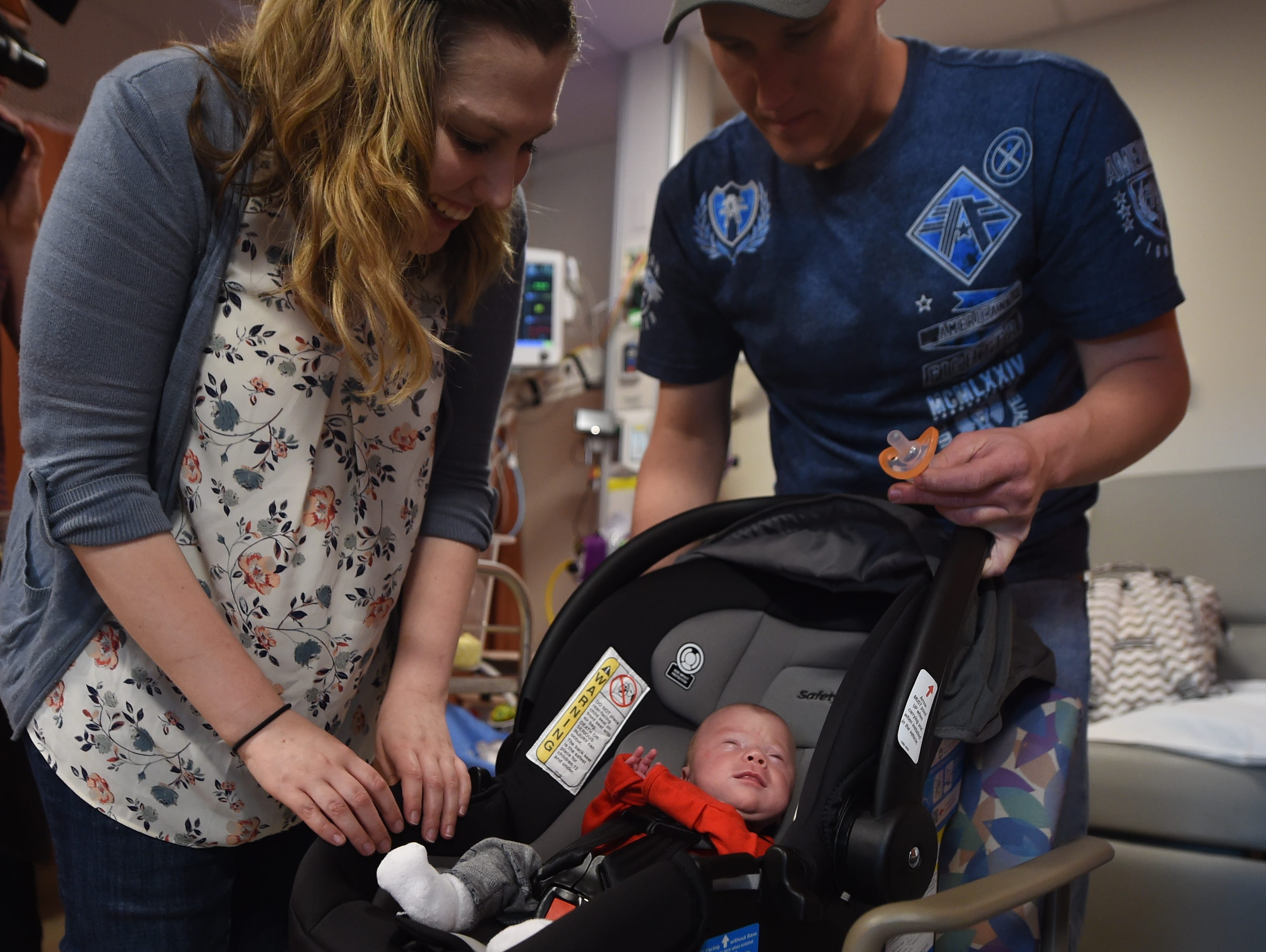 Jimmy Brown and Mary McDannell strap their son Liam McDannell inside his car seat Liam was born on New Year's Day, York County's first born child for 2019. On Tuesday, April 9 graduated from the NICU and would visit his home in Adams County for the first time.