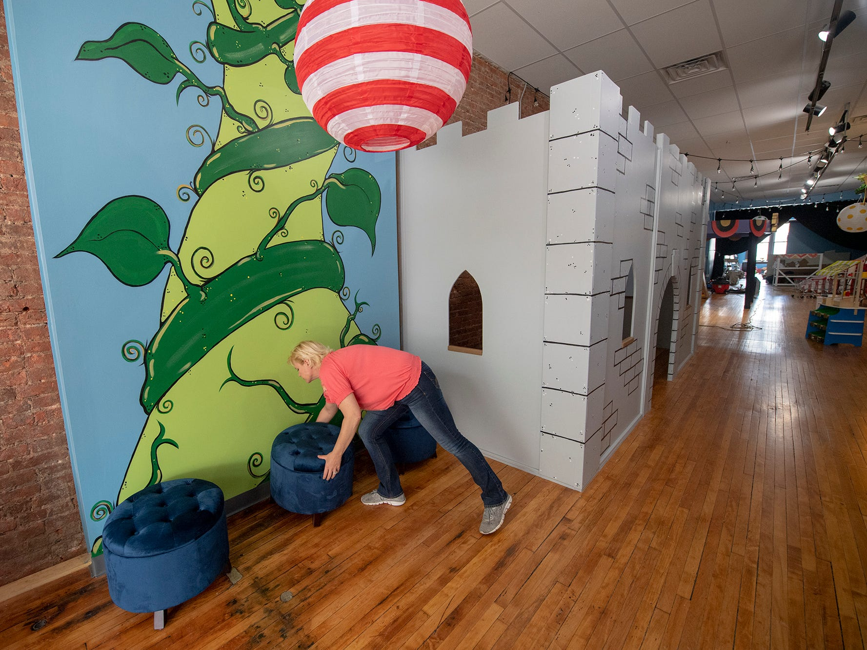 Manager Heidi Wildasin arranges seats at the base of the beanstalk at The Curious Little Playhouse, located at 41 W. Market St. in York.