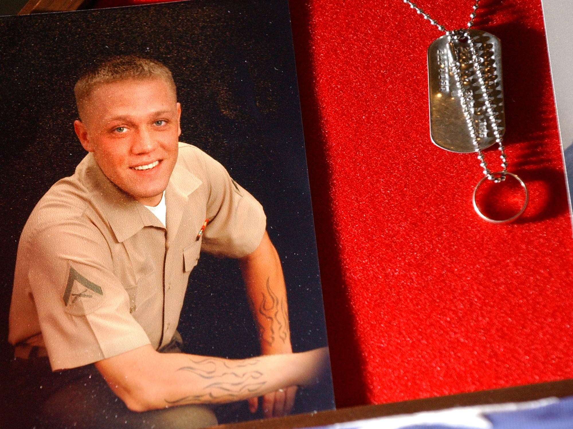 U.S. Marine Lance Cpl. Jeffery S. Blanton, 23, of Georgia, died Dec. 12, 2004, fighting in Iraq's Al Anbar province. He was assigned to the 1st Battalion, 3rd Marine Regiment, 3rd Marine Division. His wife, Amber, is from Conewago Township. Here, his dog tags and wedding ring hang next to his photo. Although wounded the month before his death, Blanton longed to return to his fellow Marines, his wife said. He returned to duty two days before his death