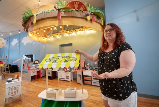 Owner Jen Swanner stands in front of the Diner, one of the interactive play areas inside the new Curious Little Playhouse in downtown York.