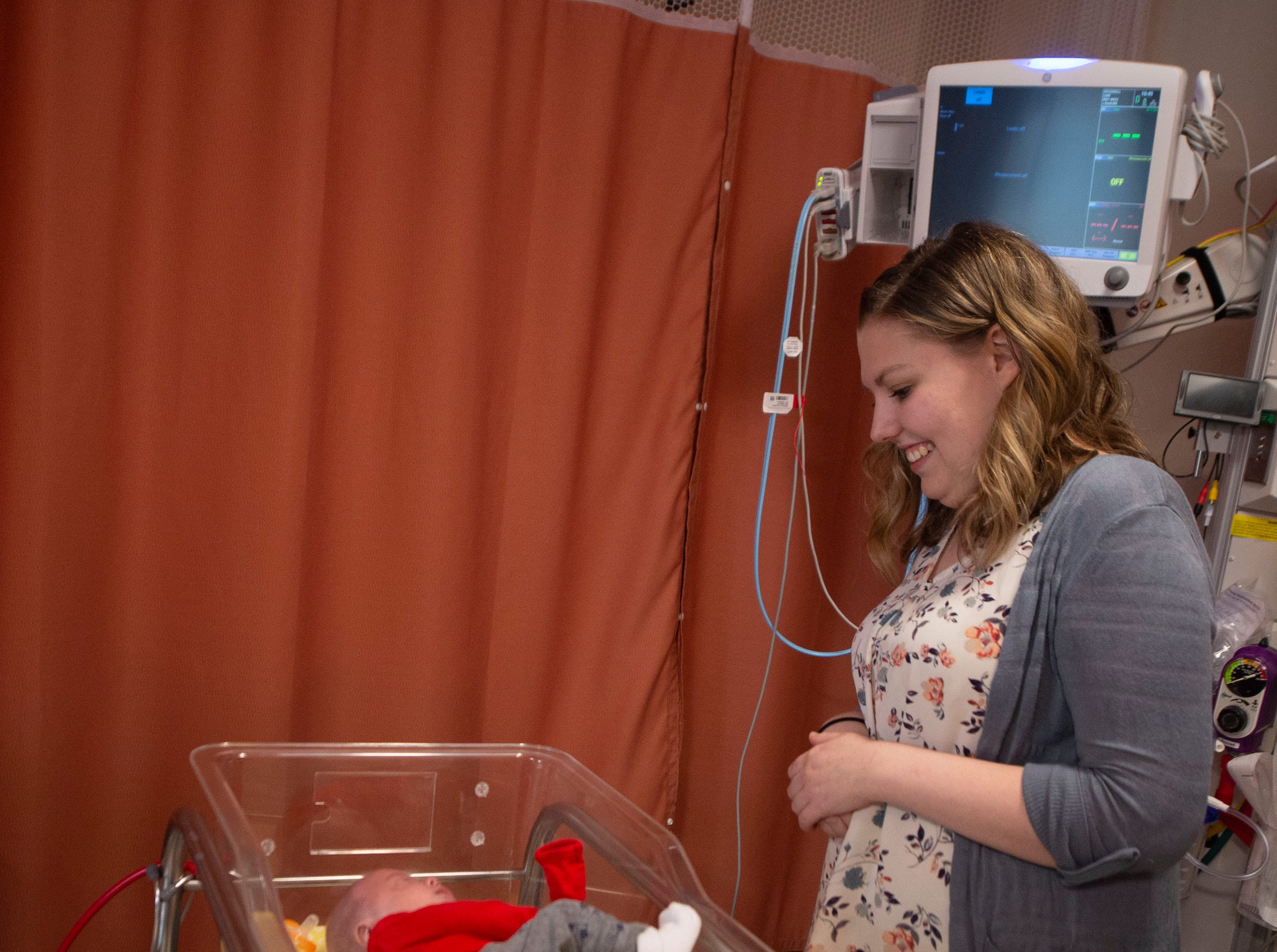 Mary McDannell with her son Liam McDannell inside his crib at WellSpan York Hospital. Liam was born on New Year's Day, York County's first born child for 2019. On Tuesday, April 9 graduated from the NICU and would visit his home in Adams County for the first time.