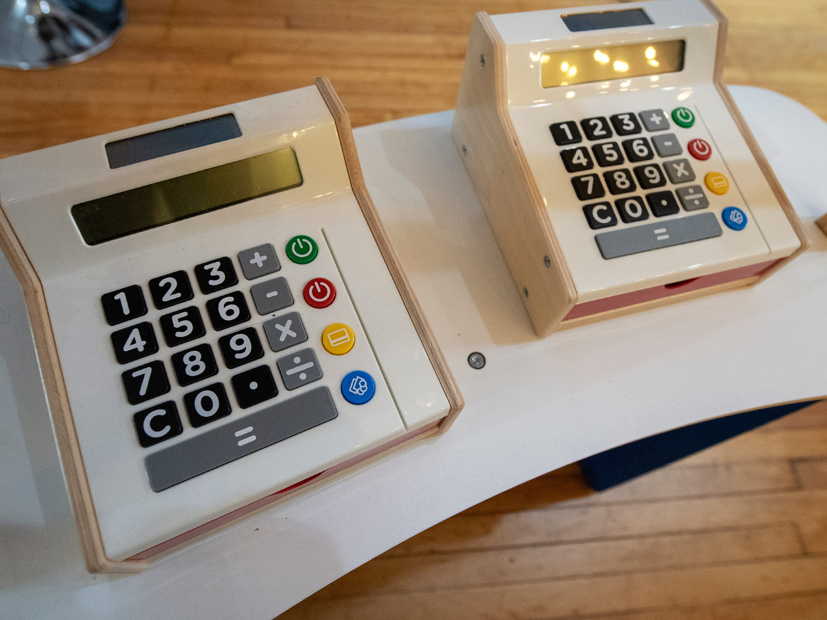 Play cash registers at The Diner will help children count play money at a restaurant inside The Curious Little Playhouse.
