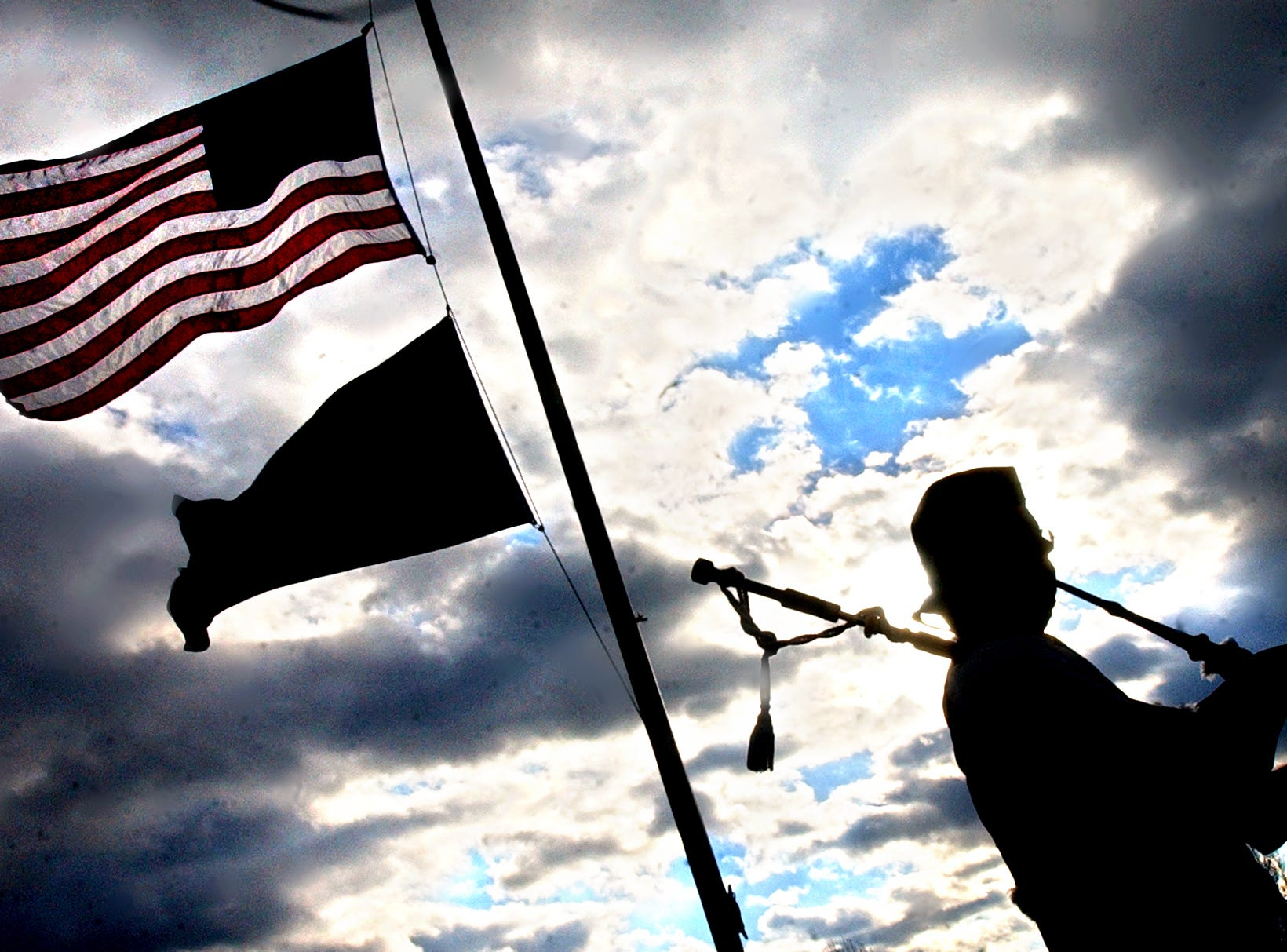 A man practices bagpipes he played at the service for U.S. Marine Cpl. Michael R. Cohen,  23, of Jacobus, who died Nov. 22, 2004, as a result of enemy action in Al Anbar Province, Iraq. Cohen was assigned to 1st Battalion, 3rd Marine Regiment, 3rd Marine Division, III Marine Expeditionary Force, Marine Corps Base Hawaii.