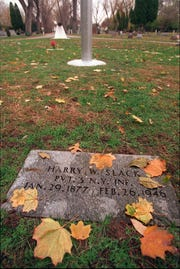 The grave of Harry W. Slack is covered with fall leaves at the Irondequoit Cemetery Friday, November 10, 1995. Slack was one of the Strong Memorial patients secretly injected with plutonium in 1946. (Staff Photo/Shawn Dowd)