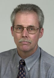 Democrat and Chronicle columnist Mark Hare in 2002; he now is retired.