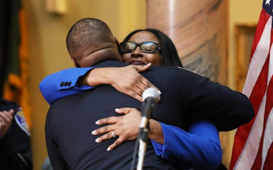 Mayor Lovely Warren hugs La'Ron Singletary in this April 9 file photo after announcing him as the city's next police chief. Singletary is set to step into the role on July 1.