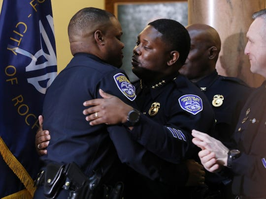 La'Ron Singletary hugs Mark Simmons, interim Rochester police chief, after Mayor Lovely Warren announced Singletary as the new chief.
