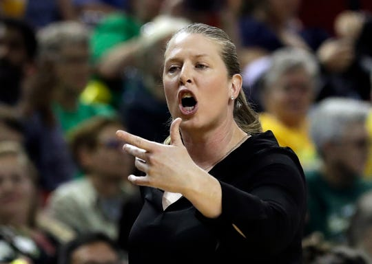 New York Liberty head coach Katie Smith yells toward the court against the Seattle Storm in the first of a WNBA basketball game Friday, Aug. 17, 2018, in Seattle.