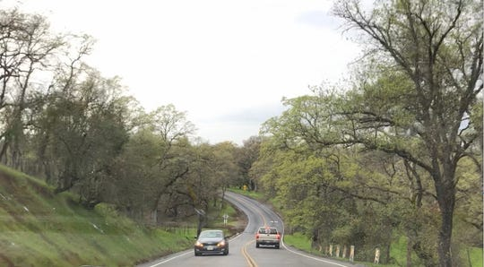 Cars navigate the windy road out of Lake California in this April 2, 2019 picture.