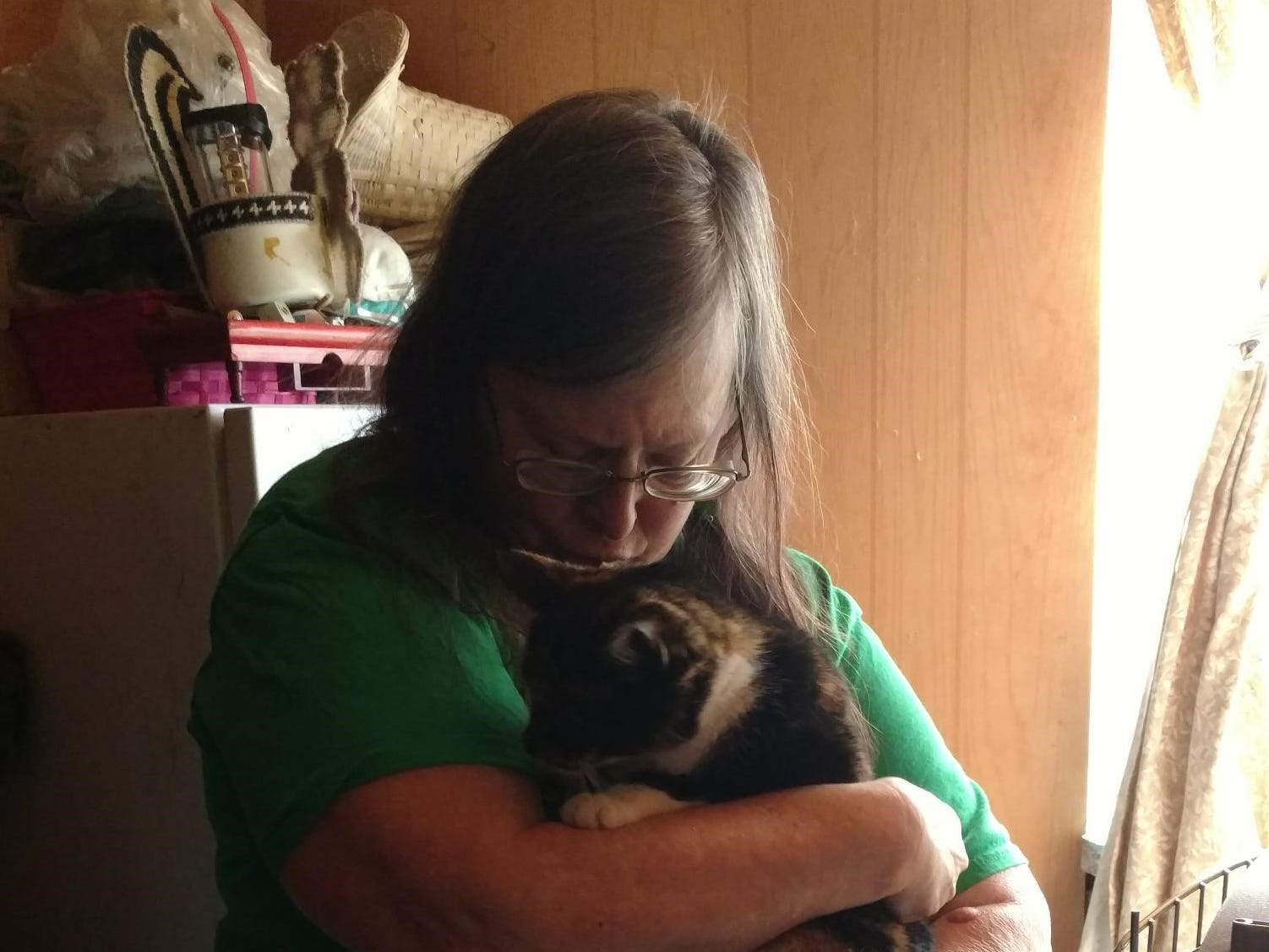 """Millie comes home: When rescuers checked the cat's microchip, they confirmed it was Millie, Henderson said. """"...I was really happy, and I cried."""""""