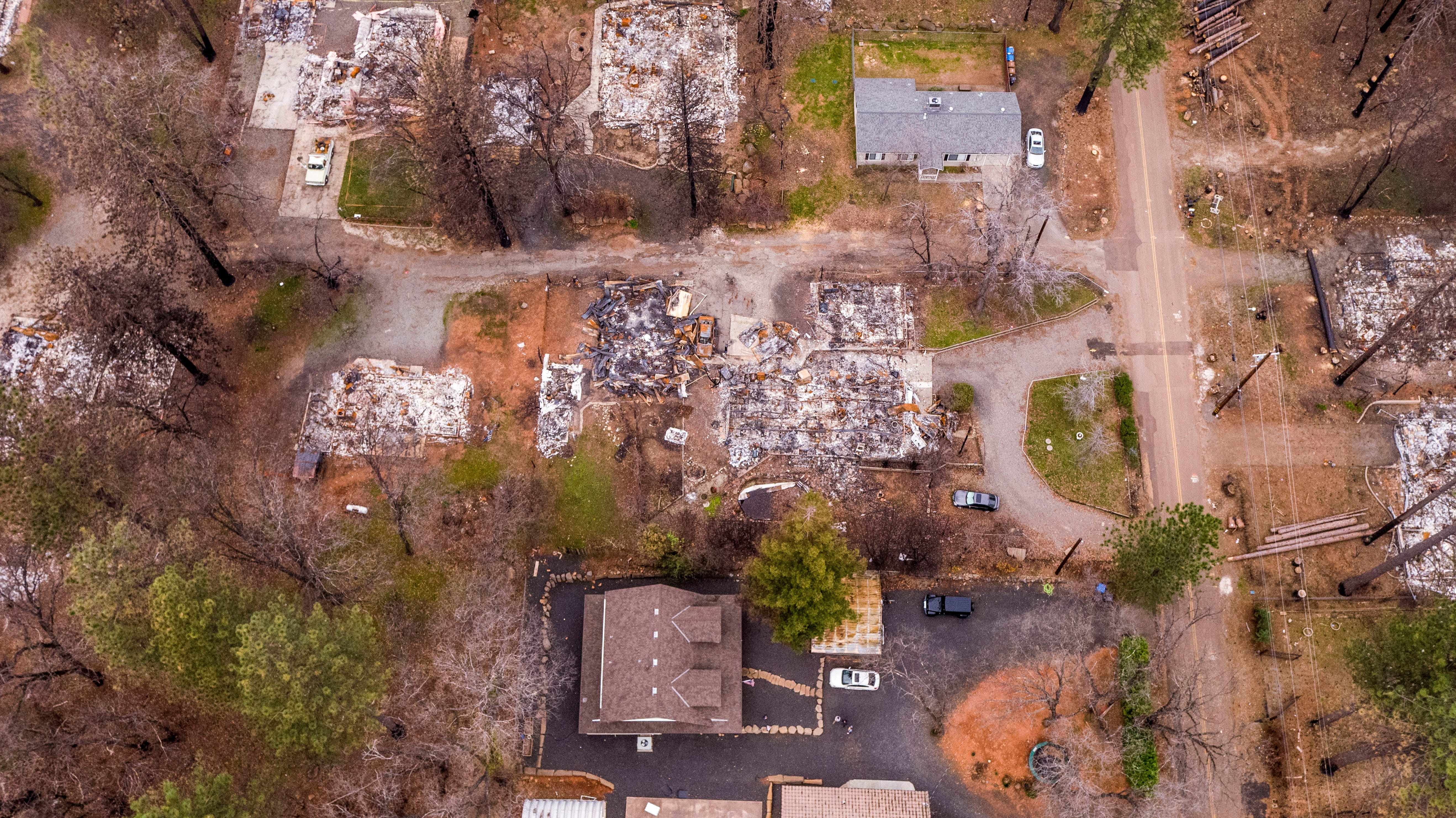 A aerial image shows the home of Sean and Dawn Herr, bottom center, in Paradise on Tuesday, March 19, 2019. The Herr home, built in 2010 to new fire-resistant building standards, survived the fire while nearby homes burned.