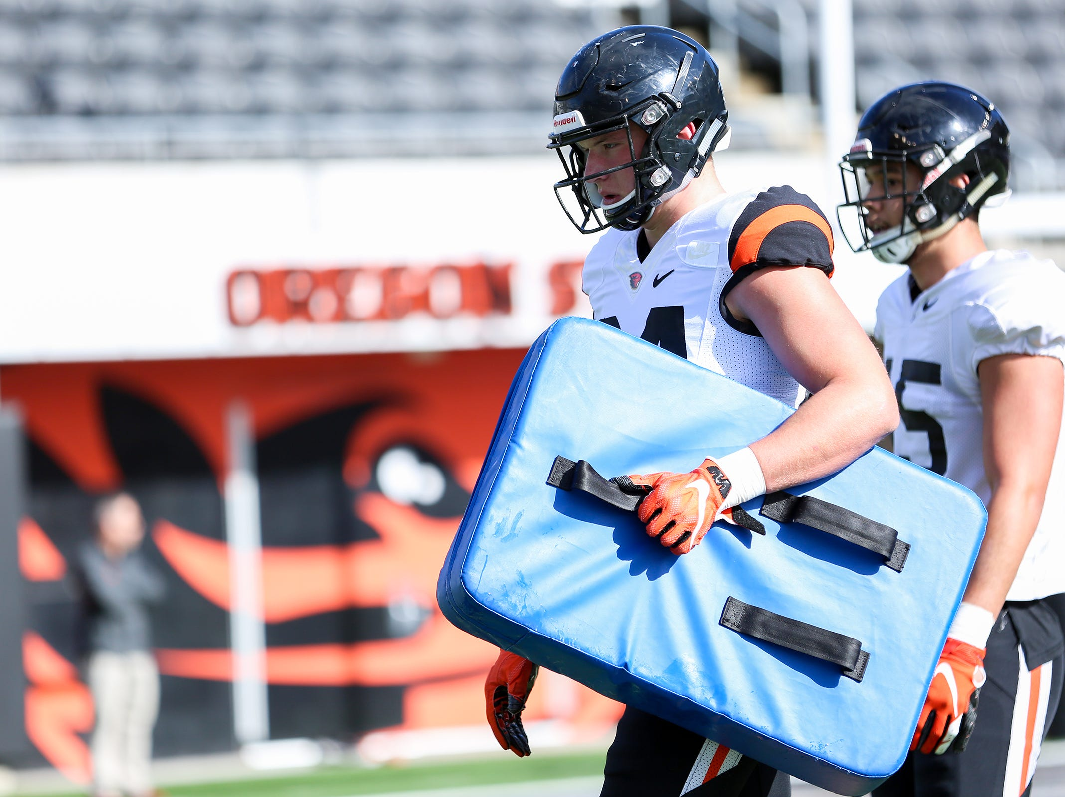 Oregon State University tight end Teagan Quitoriano (84) carries a blocking shield during practice at Oregon State University in Corvallis on April 9, 2019.