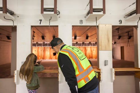 Derek LeBlanc, president of the Kids S.A.F.E. Foundation, watches over Tarralynn Hill, 10, as she shoots targets during a gun safety class for children taught by LeBlanc at the Albany Rifle and Pistol Club in Albany, Oregon, April 6, 2019. This is the second in a series of classes where the kids will learn the fundamentals of safe handling of a firearm. LeBlanc is the lead writer of Senate Bill 801, which would enable school districts and public charter schools to offer an annual firearm safety and accident prevention class to first-grade students. No real firearms or live ammunition can be used during the class, according to the bill.