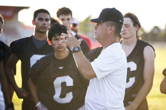 Coach Shane Hedrick talks to players at a Central High School football practice on Tuesday, Aug. 22, 2017.
