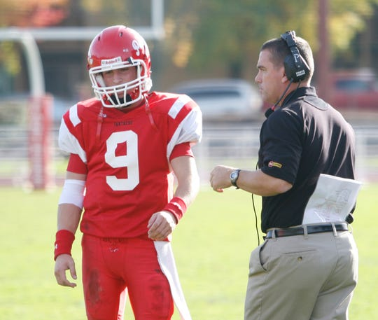 Central High School's Grant Hedrick talks with his father and head coach Shane Hedrick on Nov. 15, 2008.