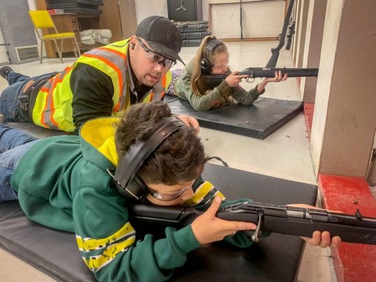 Derek LeBlanc, president of the Kids S.A.F.E. Foundation, center, watches over Diego Vargas, 9, left and Tarralynn Hill, 10, as they shoot targets during a gun safety class for children taught by LeBlanc.
