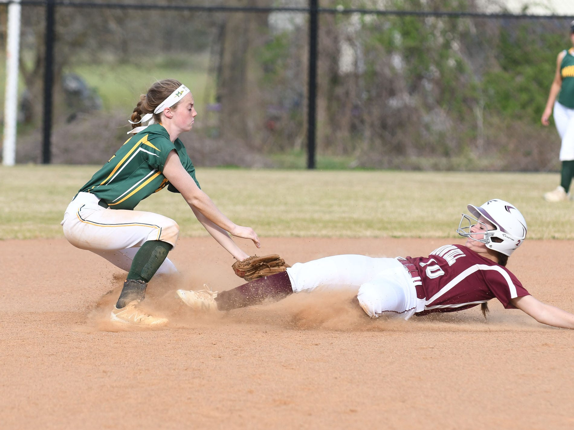 Mardela's Alexa Jones lays attempts to lay down the tag on  Snow Hill's Lexi Harper on Monday, April 8, 2019 in Snow Hill, Md.