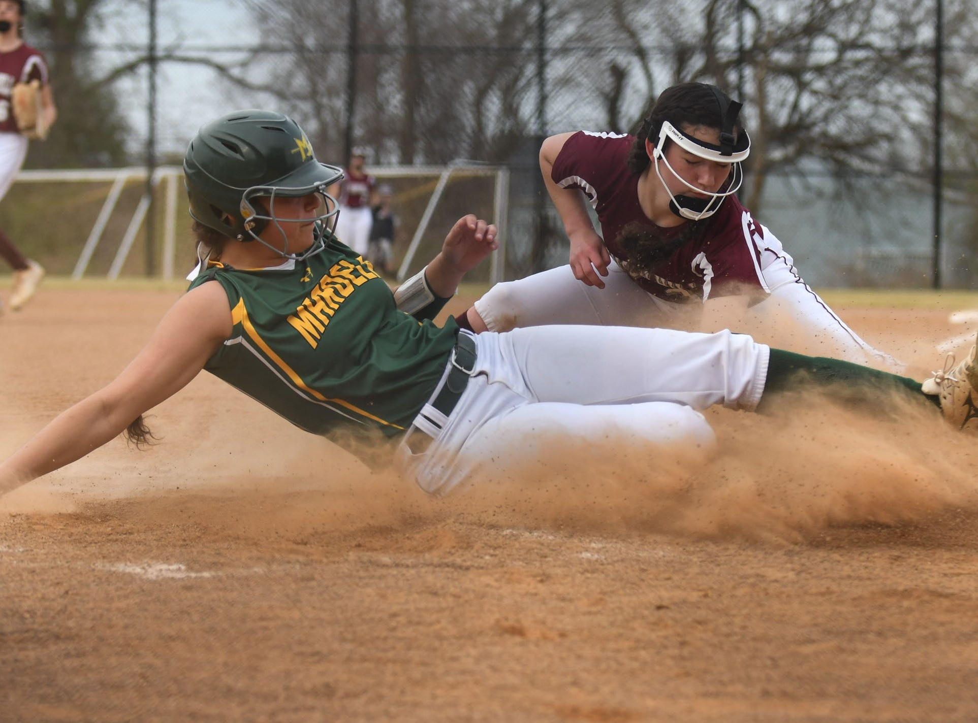 Mardela's Megan Caputo slides into home against Snow Hill on Monday, April 8, 2019 in Snow Hill, Md.
