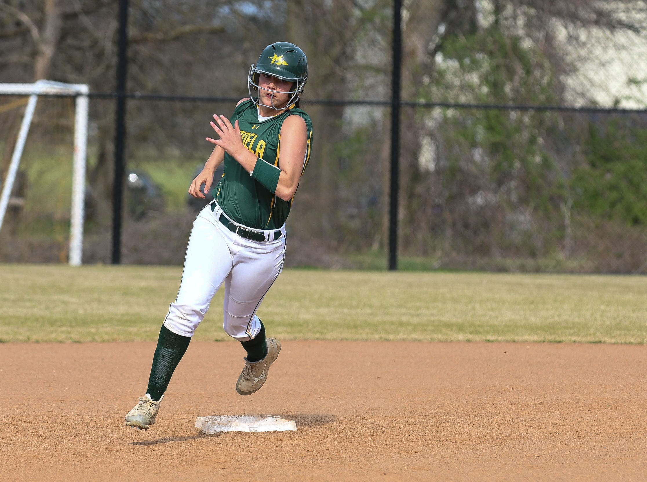 Mardela's Megan Caputo rounds second against Snow Hill on Monday, April 8, 2019 in Snow Hill, Md.