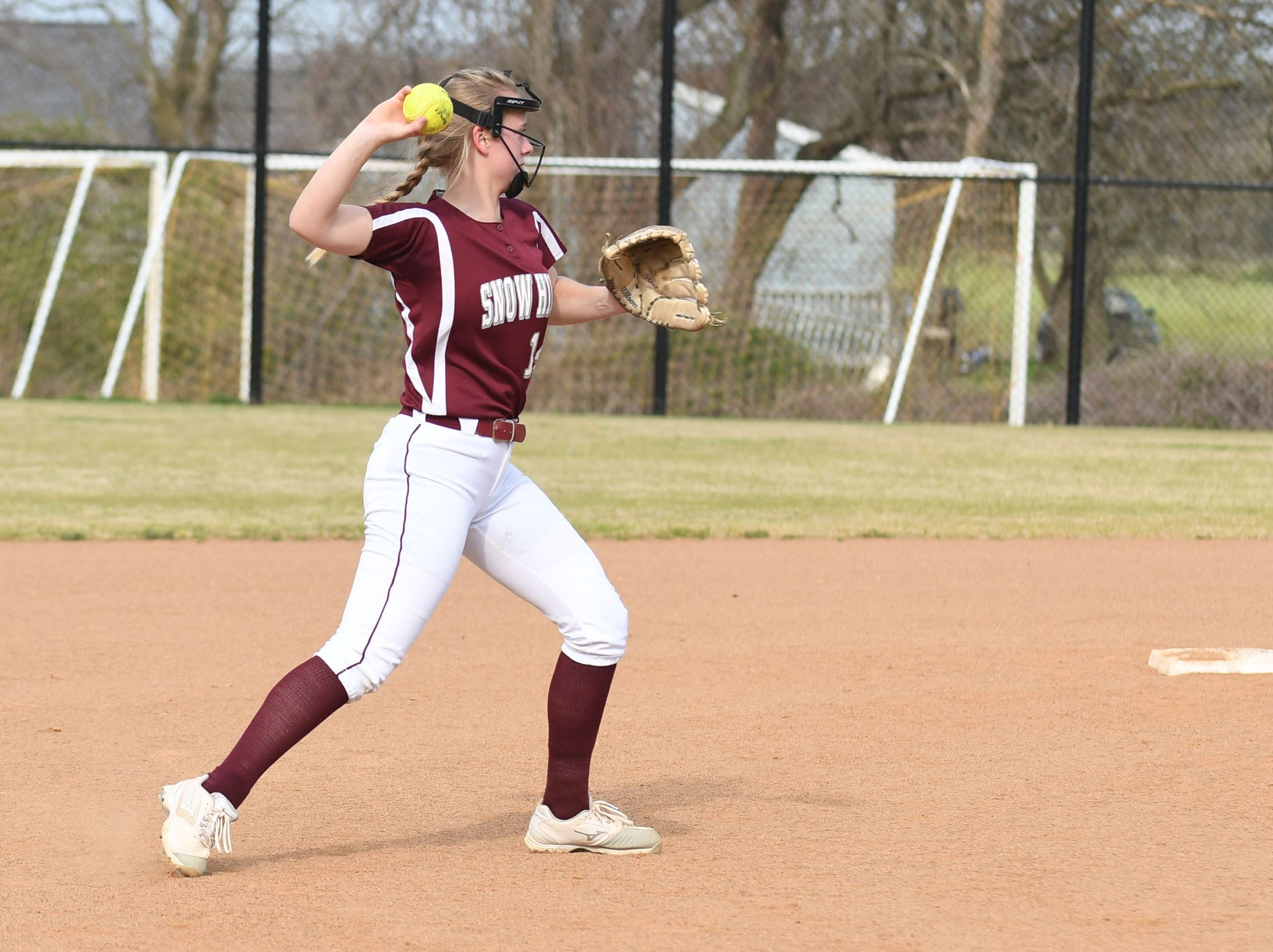 Snow Hill's Hailey Farlow with the throw to first against Mardela on Monday, April 8, 2019 in Snow Hill, Md.