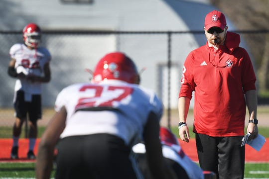USD coach Travis Johansen during spring football camp Monday, April, 8, on the outdoor practice field at the university in Vermillion.