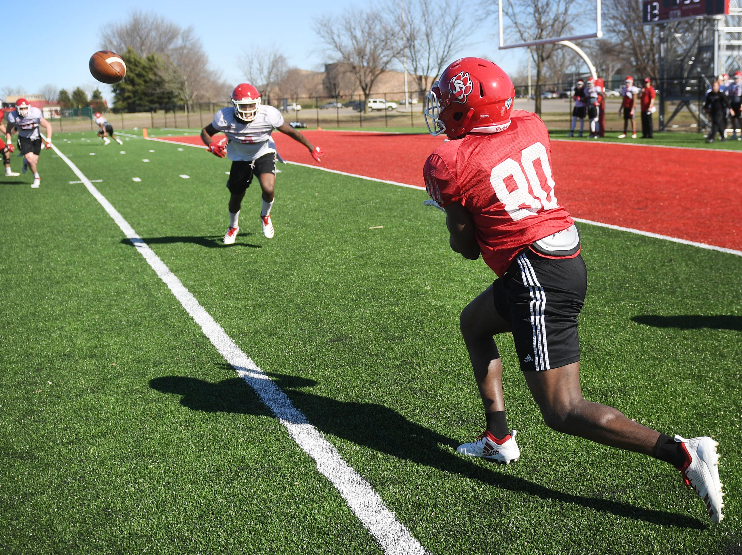 USD's Wes Eliodor (80) runs a play during spring football camp Monday, April, 8, on the outdoor practice field at the university in Vermillion.