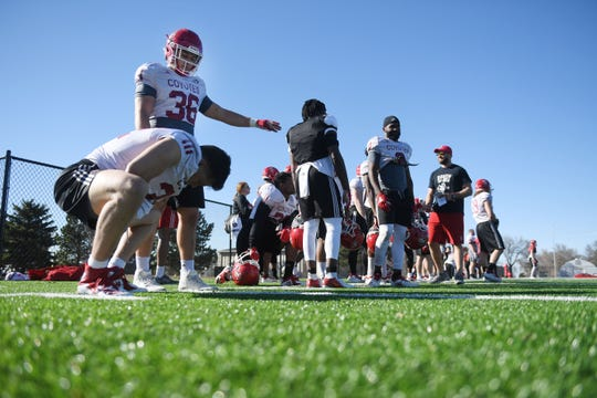 USD spring football camp Monday, April, 8, on the outdoor practice field at the university in Vermillion.