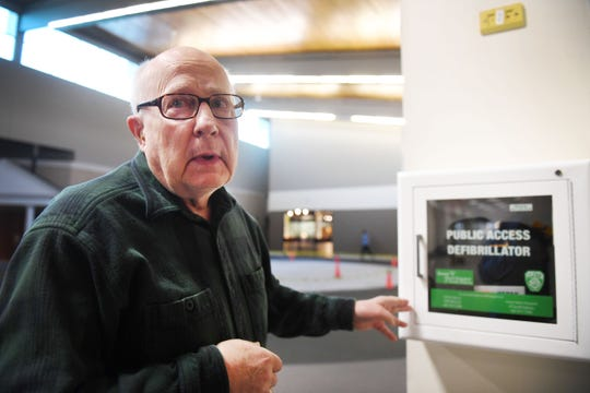 Bill Winness talks about the AED, Automated External Defibrillator, he used Tuesday, April 9, at the Western Mall in Sioux Falls. Winness' friend Keith, 81, suffered a heart attack last week during their normal walking route at the mall.