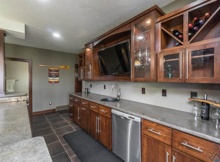 This four-bed, three-bath ranch home, located at 2305 S. Copper Crest Trail in east Sioux Falls, sold for $570,000 in the week of Feb. 18, according to weekly public property sales records from Minnehaha and Lincoln counties.
