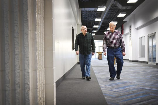 Bill Winness, left, and Ray Smidt, right, walk the Western Mall together Tuesday, April 9, in Sioux Falls. Winness and Smidt's friend Keith Clark, 81, had a heart attack last week during their morning walk. The three of them usually walk the mall together. They have been doing their morning routine without Keith until he gets better.
