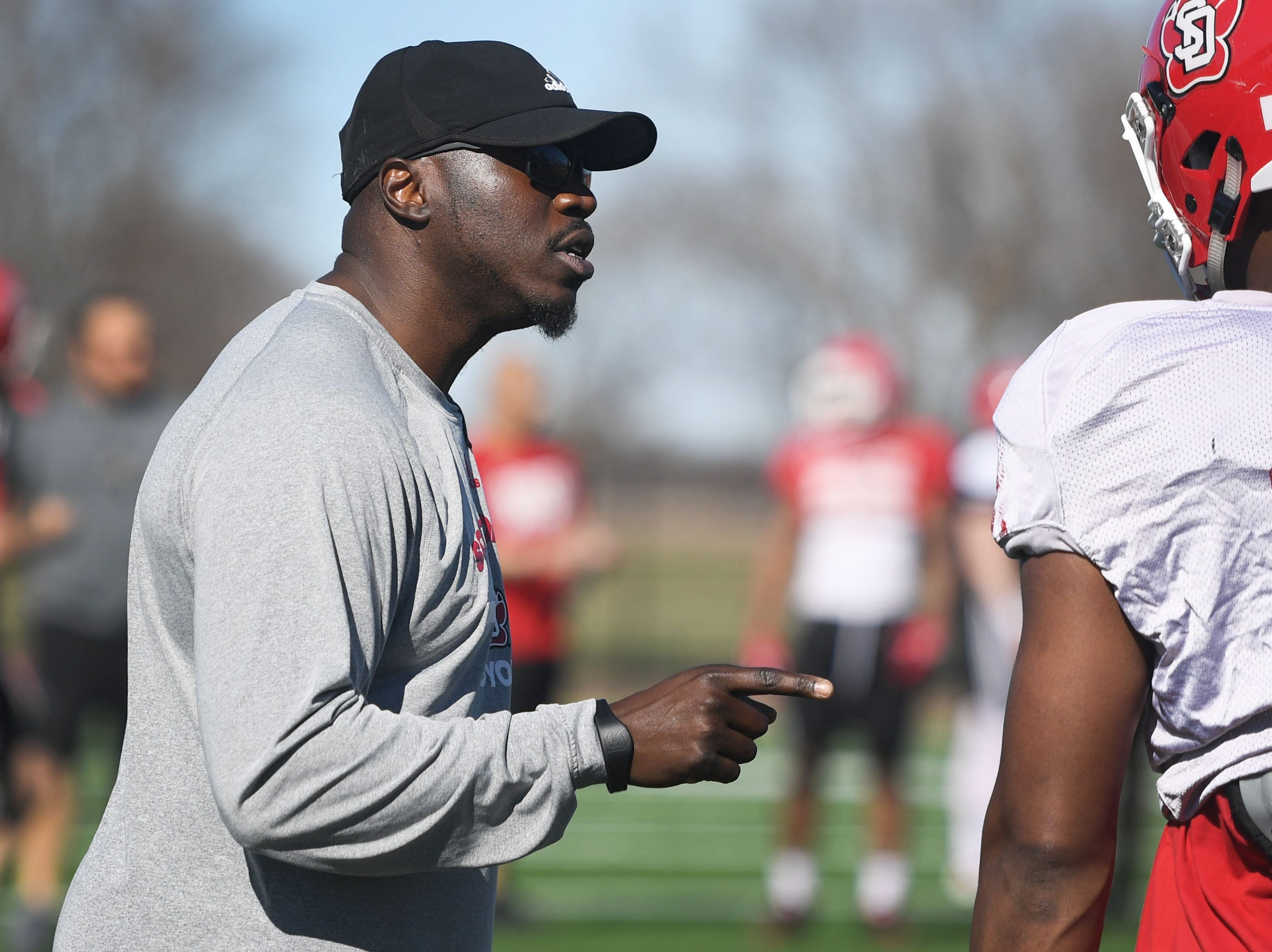 USD coach Abdul Hodge during spring football camp Monday, April, 8, on the outdoor practice field at the university in Vermillion.