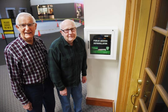 Ray Smidt and Bill Winness stand by the AED, Automated External Defibrillator, they used to save their friend Keith Clark Tuesday, April 9, at the Western Mall in Sioux Falls. Smidt and Winness' friend Keith, 81, suffered a heart attack last week during their normal walking route at the mall.