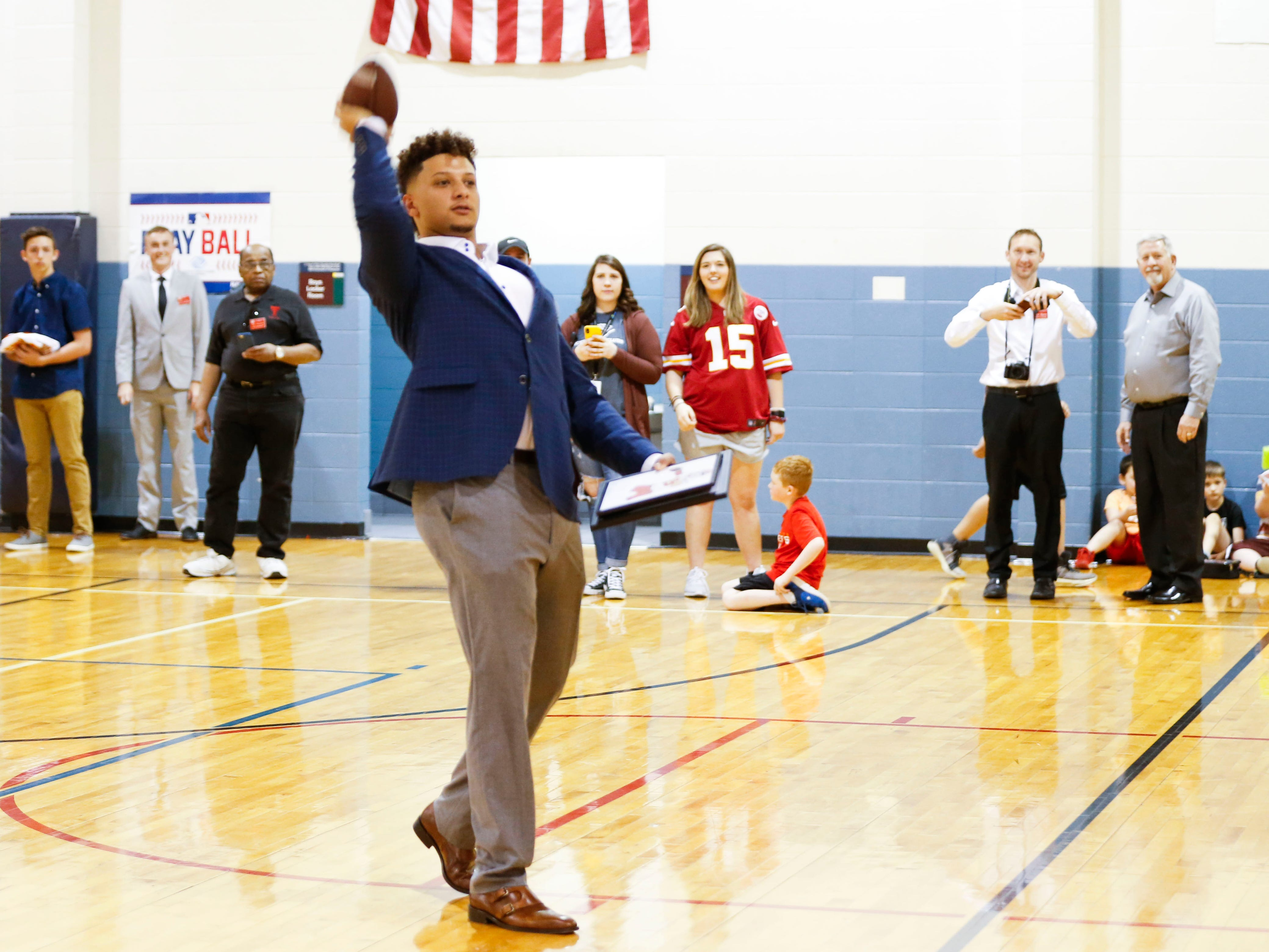 Patrick Mahomes II tosses a football back to a kid in the crowd while speaking at the Boys & Girls Clubs of Springfield on Tuesday, April 9, 2019.