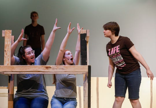 "Anastasia Friesen, right, along with Victoria Kessinger, left, Alandra Hutchens, center, rehearse the musical ""Kelly the Destroyer Versus the Springfield Cobras"" at Central High School on Monday, April 8, 2019."