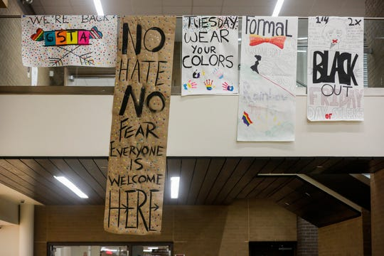 Students at Kickapoo High School made new, larger posters for a spirit week after originals made by the Gay Straight Trans Alliance, or GSTA, were ripped down Friday.
