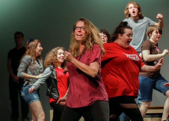"Instructor Gretchen Teague, center, rehearses a dance scene from the musical ""Kelly the Destroyer Versus the Springfield Cobras"" with cast members at Central High School on Monday, April 8, 2019."