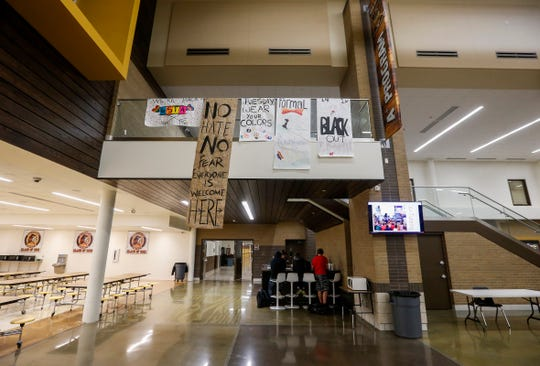 After the Friday incident, when a Gay Straight Trans Alliance, or GSTA, poster was ripped down, Kickapoo High School students created a new, larger poster.