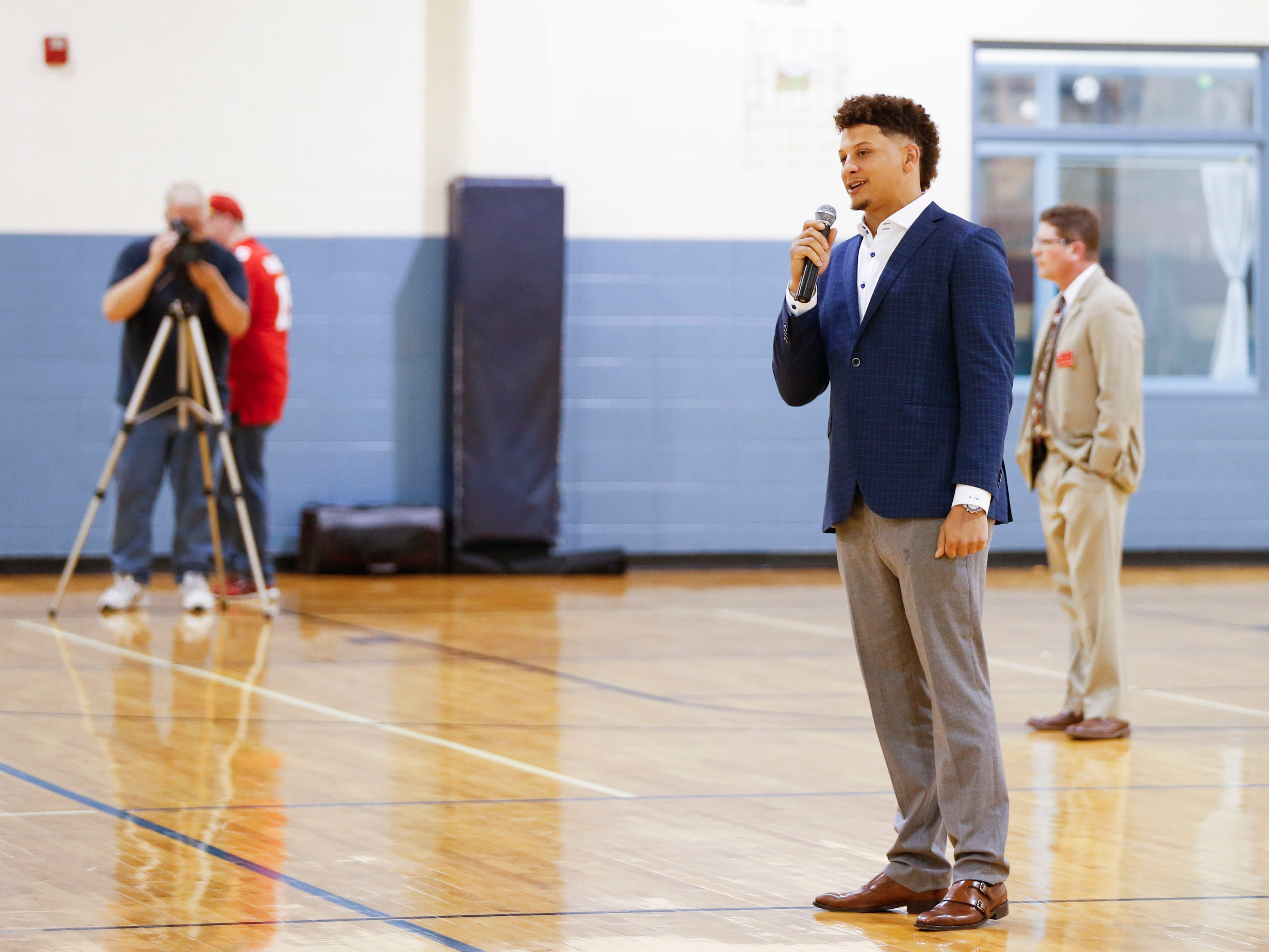 Patrick Mahomes II speaks a group of kids at the Boys & Girls Clubs of Springfield before speaking at the annual 23rd Annual Steak & Steak Dinner on Tuesday, April 9, 2019.