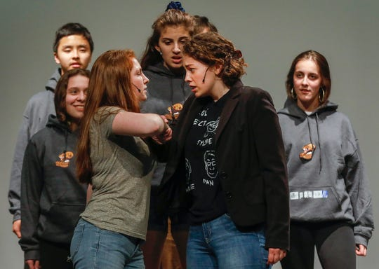 "Alandra Hutchens, center left, and Molly Callahan, center right, rehearse a scene from the musical ""Kelly the Destroyer Versus the Springfield Cobras"" with other cast members at Central High School on Monday, April 8, 2019."